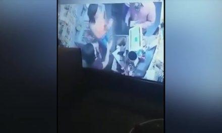 Surveillance Video Captures Robbery at Gunpoint
