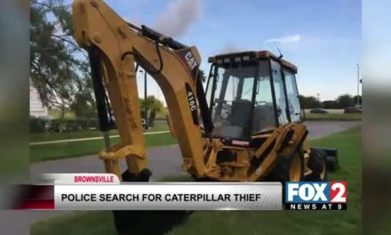 Police Search for Caterpillar Loader