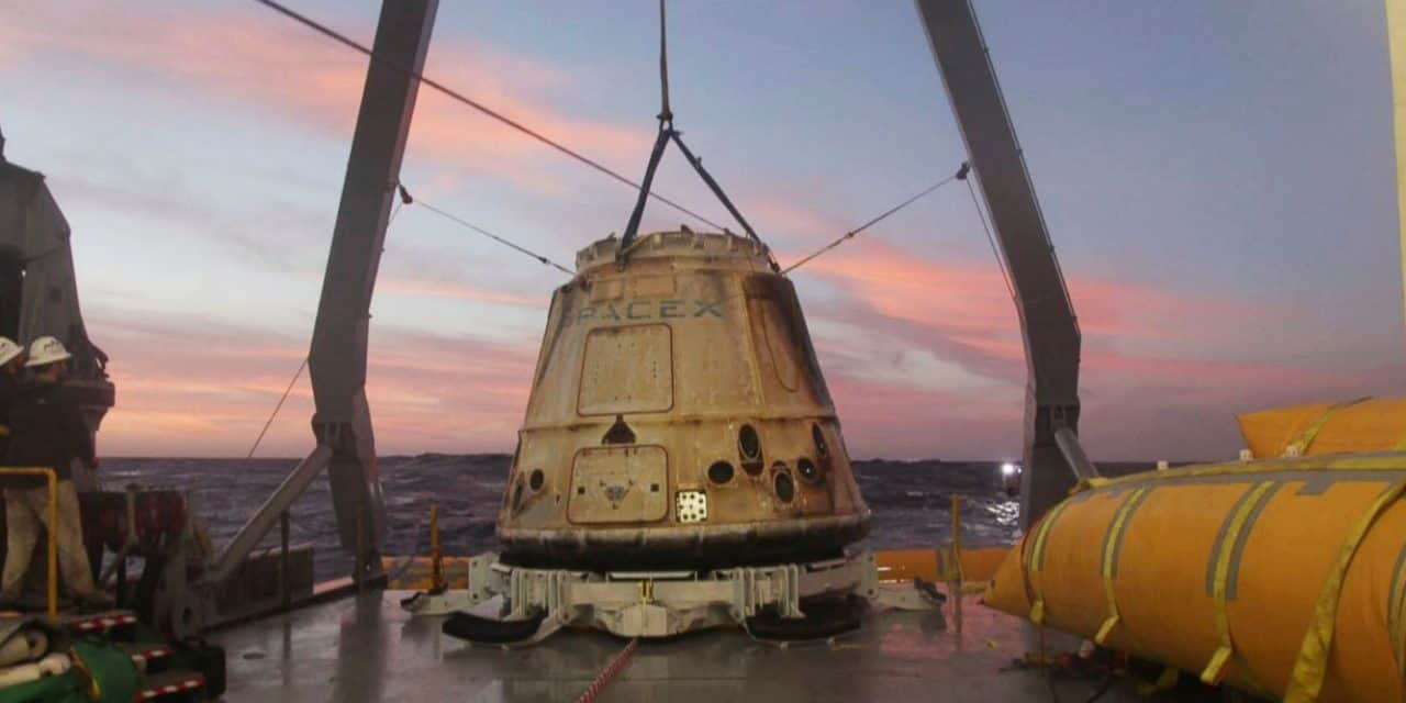 SpaceX says it will fly 2 people to moon next year