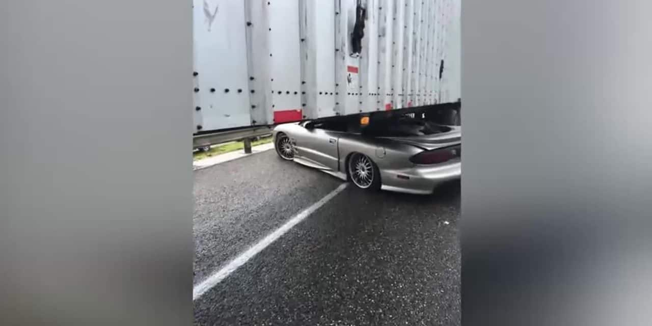 Sports Car Trapped Under Tractor Trailer