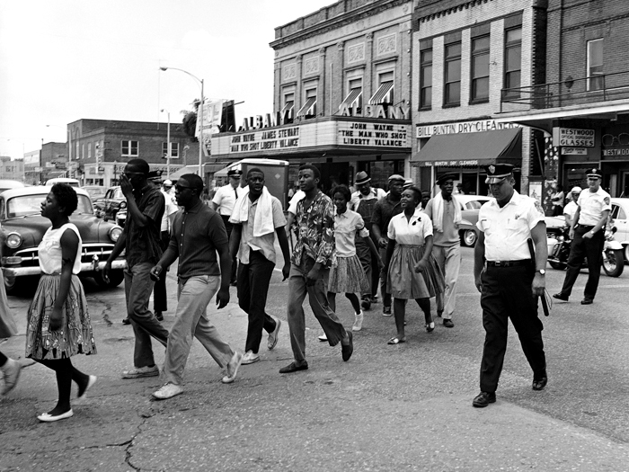 Police lead protesters to the Albany jail on July 11, 1962
