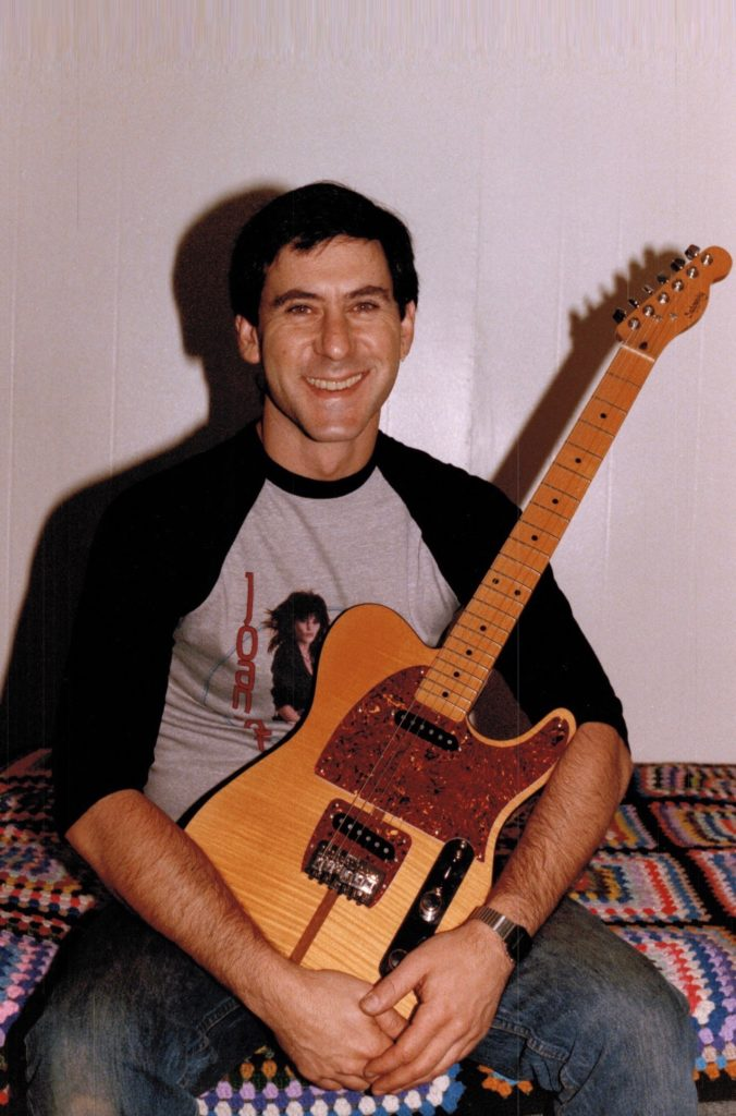"""Roger Sadowsky holding one of the """"Ejacucaster"""" guitars he built for Prince."""