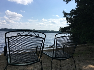 Two Chairs by Water