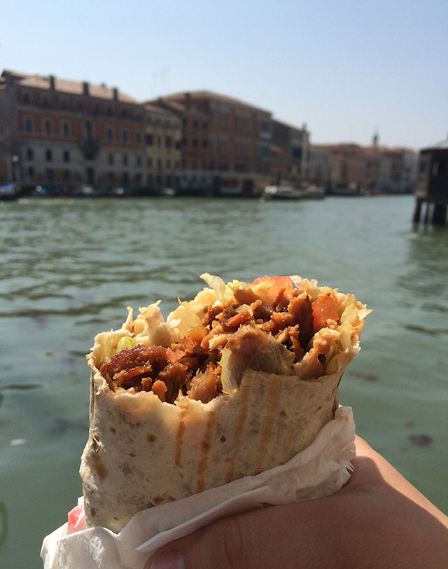 Enjoying kebabs in Venice, Italy
