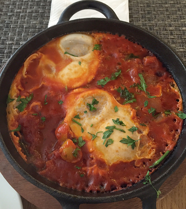 Eating shakshuka on tour in Israel
