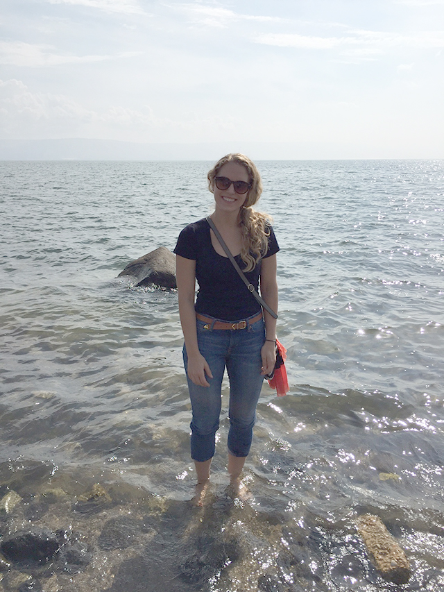 Karissa dips her feet in the Sea of Galilee in Israel