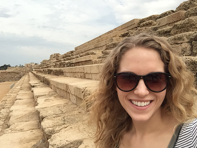 Karissa explores the ruins of Caesarea on tour in Israel