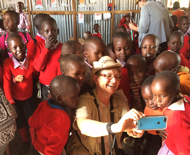 Denise visits with the schoolchildren of the Masai Mara in Kenya