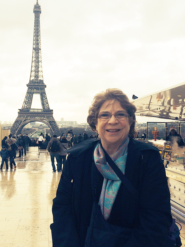 Verna in front of the Eiffel Tower in Paris, France