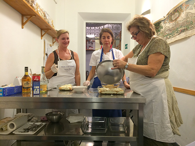 Making tiramisu at a cooking class in Florence, Italy