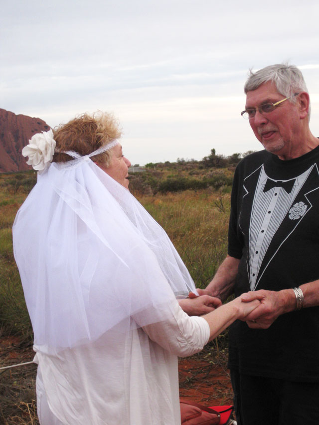Renewing wedding vows at Ayers Rock, Uluru, Australia