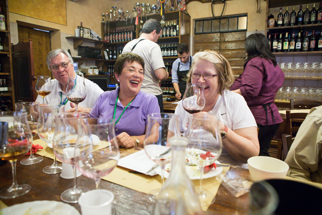 women-enjoying-a-winetasting-in-Italy-by-Dominic-Casserly