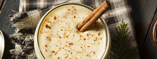 egg nog with cinnamon stick