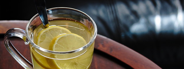 hot toddy in a clear glass with lemon