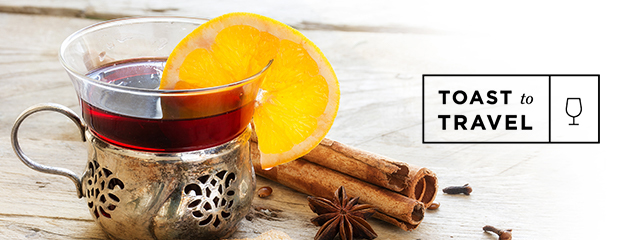 mulled wine and cinnamon with toast to travel logo