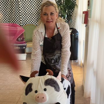 Zita with a cow