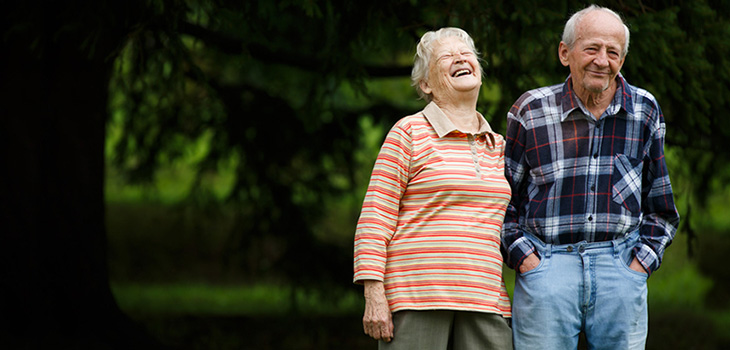 couple enjoying a laugh and a walk in the woods