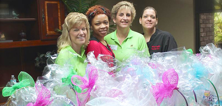 4 female staff members with stuffed easter baskets