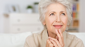 elderly lady with hand on chin
