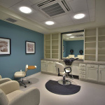 Salon with blue walls and cream colored salon chairs