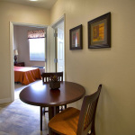 small kitchen area with bistro table and chairs