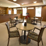 recreation area with tables, popcorn maker, drink refrigerator and microwave