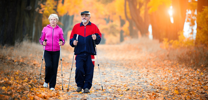 couple walking on a trail on an autumn day
