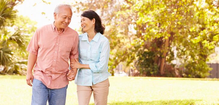 couple enjoying a walk outside on a sunny day