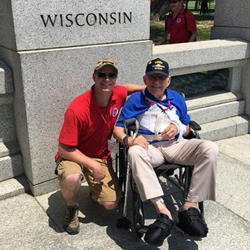 Richard next to Wisconsin memorial