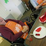 Resident enjoying a woodworking project with Home Depot during men's group.