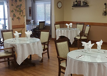 Resident dining area with nicely set tables