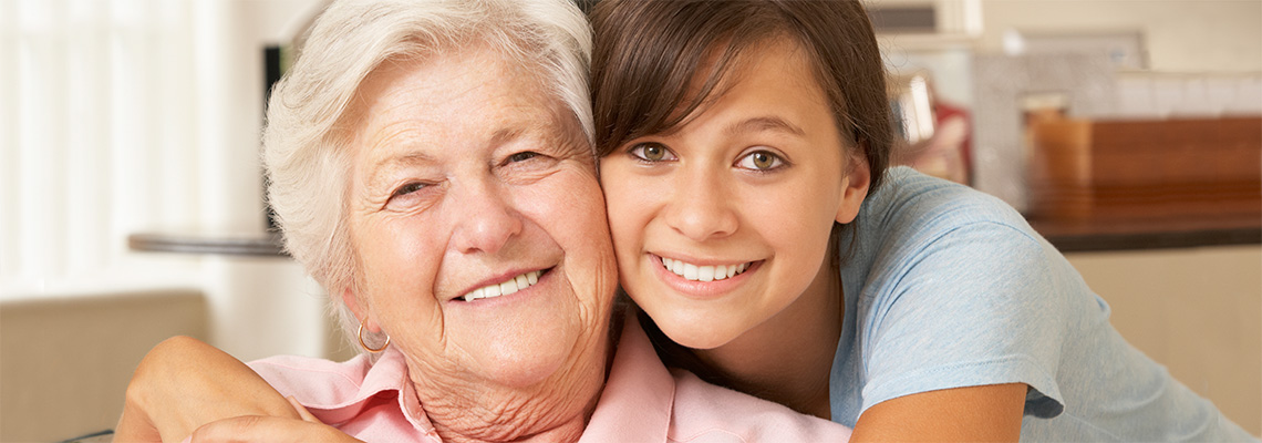 young woman hugging an elderly patient