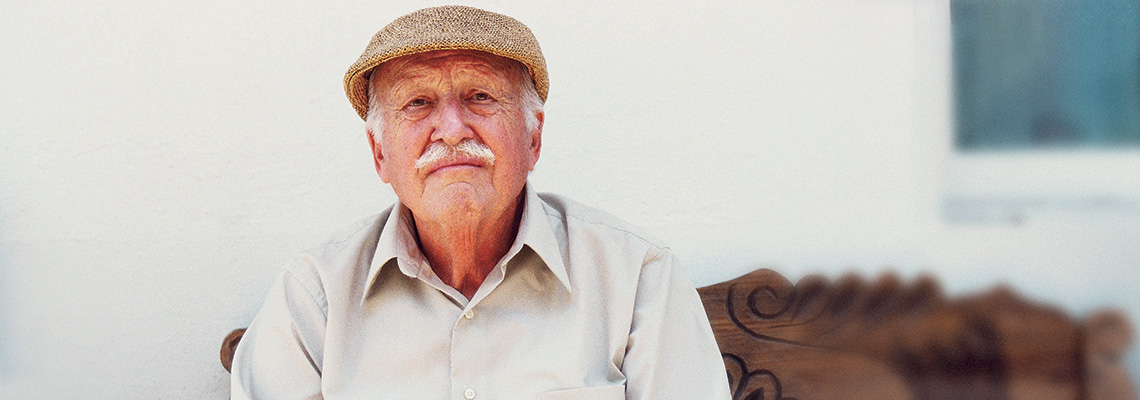 elderly gentleman wearing a newsboy cap