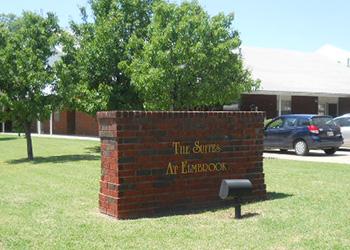 The Suites at Elmbrook exterior brick sign