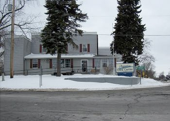The front view of Argentine Care Center on a snowy day
