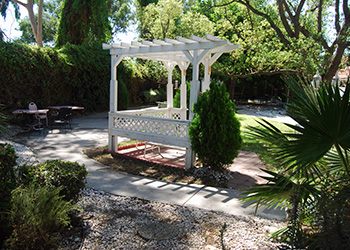 Beautiful gazebo surrounded by walking paths and a garden