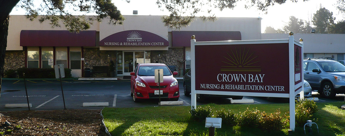 Crown Bay front entrance with awning & exterior sign