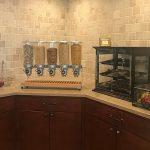 Snack area with various drinks and snacks for residents to choose from