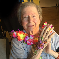 female resident at a Hawaiian themed party with a flower lei around her neck