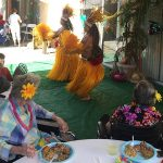 resident enjoying the Polynesian dancers putting on a show