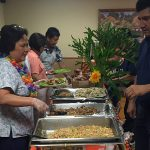 residents and staff in line at the buffet