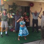 Polynesian dancers leading the residents in a hula lesson