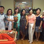 staff celebrating at the Luau and pig roast