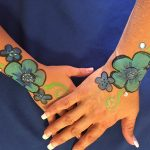 flowers painted on a nurses hands and arms