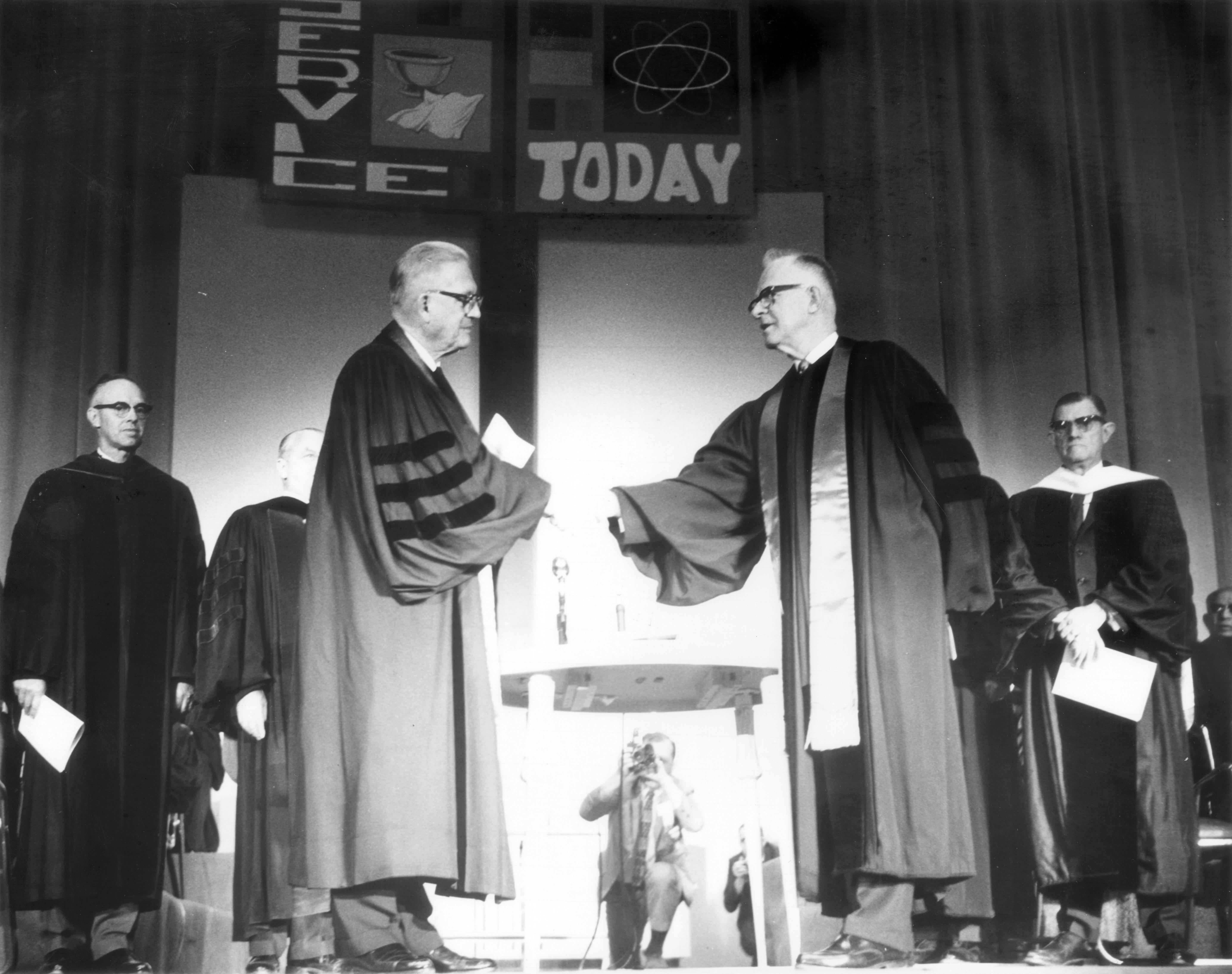 Evangelical United Brethren Bishop Bishop Reuben H. Mueller (left) and Methodist Bishop Lloyd C. Wicke