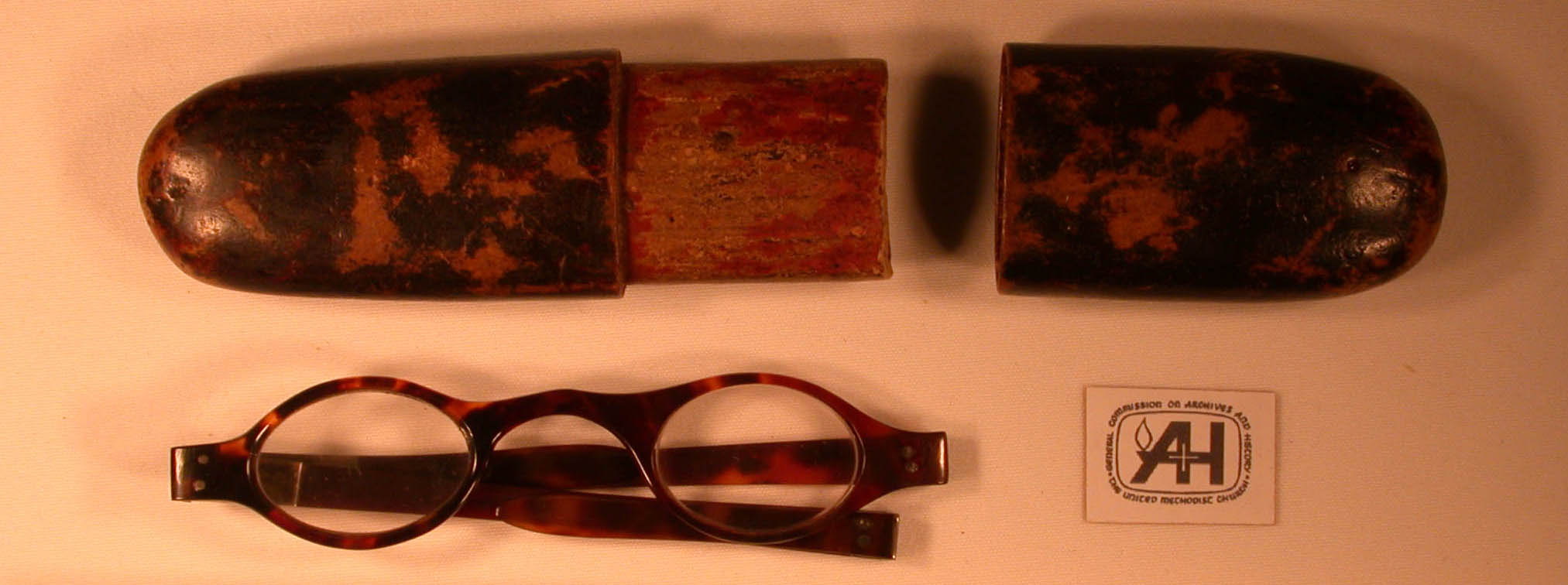 Asbury's glasses and glass case