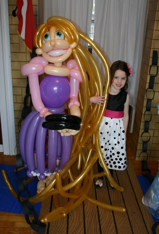 Birthday girl with her special balloon sculpture