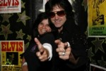 Bay Area Elvis Impersonator Rick Torres during meet and greet in front of Elvis Posters backdrop available for your event!