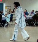 "Bay Areas #1 Elvis Impersonator and Tribute Artist Rick Torres wearing the ""Aqua Blue Vine"" suit during Pacifica Show."