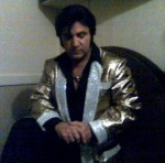 Bay Area's #1 elvis Impersonator Rick Torres in 1956 Rock a Billy attire taking a minute for prayer